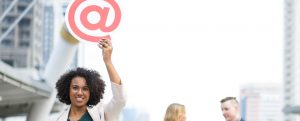 woman holding email sign
