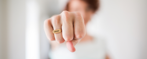 woman punching with resume on her ring